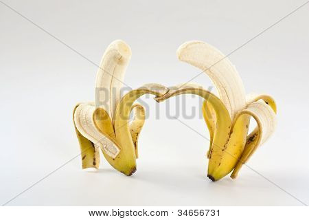 Two Holding Hands Bananas Isolated Over White