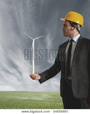Hombre de negocios y de la turbina de viento
