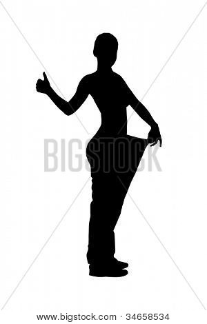A silhouette of a full length portrait of a weightloss woman giving a thumb up isolated on white background