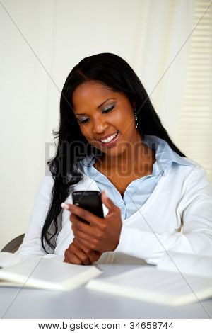 Pretty Young Woman Sending A Sms With The Mobile