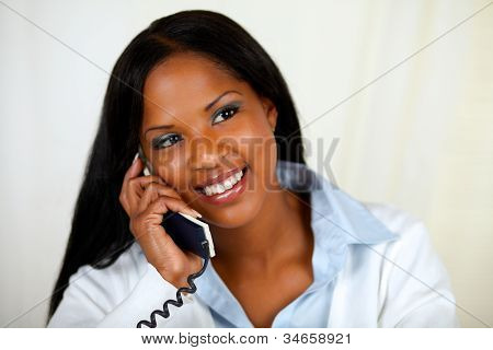 African Woman Conversing On Phone