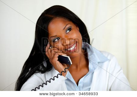 Young Black Woman Conversing On Phone
