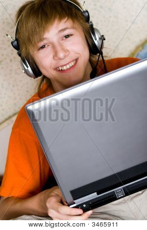 Smiling Teenager With A Laptop