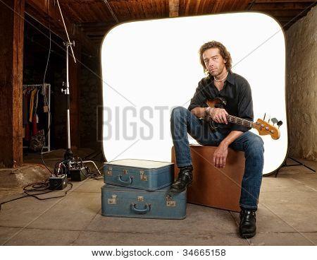 Musician With Guitar In Studio