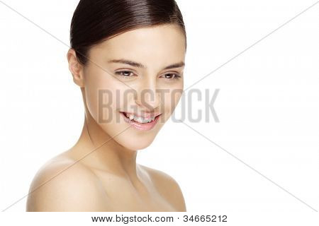 beauty portrait of smiling female with natural makeup. Carefully retouched to retain skin texture