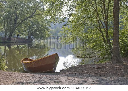 Idle Rowboat By A Scenic Lake