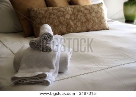 Luxury Hotel Room With Towels On Bed