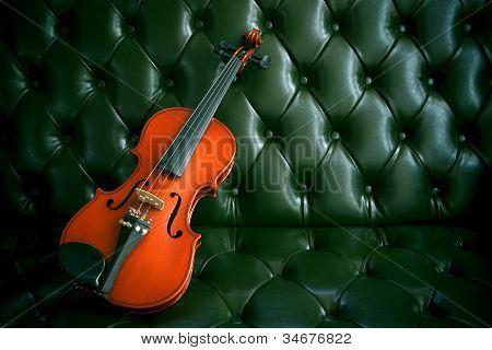 violin on luxury dark green leather background