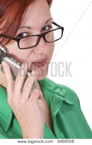 Redheaded Girl Talking On A Mobile Phone