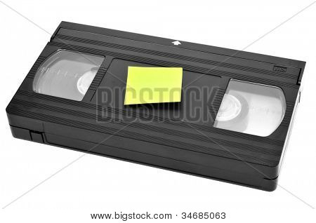 a videotape with a blank sticky note on a white background