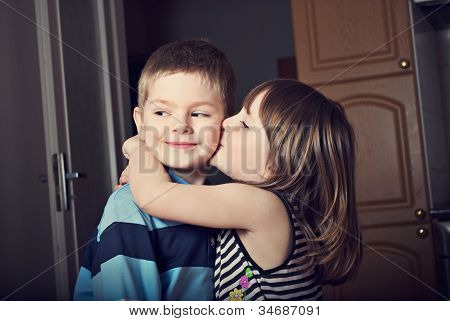 Adorable Little Girl Kissing A Boy