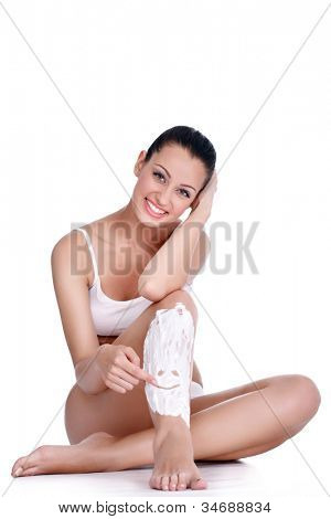 shaving legs, Young woman drawing  smiley in shaving foam