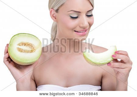 Portrait of healthy smiling woman holding a slice of cantaloupe