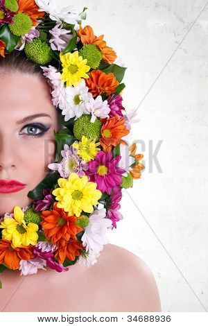 Close-up make-up woman�¢�?�?s face with border of flowers, isolated on white background