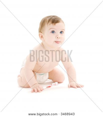 Baby Boy In Diaper With Toothbrush Sticking Tongue Out