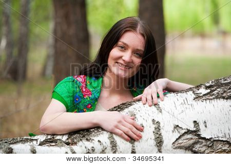 Beautiful woman near birch