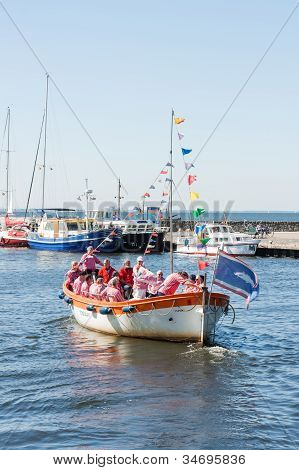 Urk, The Netherlands - May 26: A Tourist Vessel With The Members Of A Traditional Sailors Choir Sing