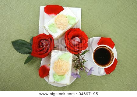 sweet breakfast : whipped cream cake with roses and hot black coffee