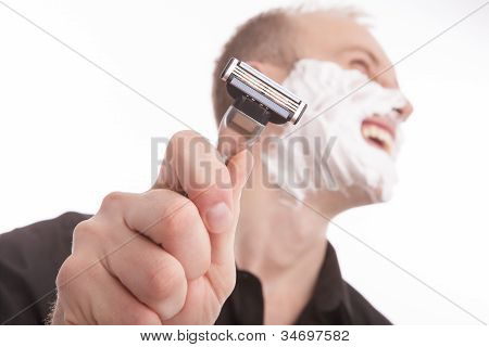 Portrait Of A Smiling Man With Razor