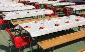Many Tables Set Outdoors For A Lunch With Many Guests poster