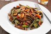 stock photo of snow peas  - Beef stir fry with beans broccoli sugar snap or snow peas and carrots - JPG