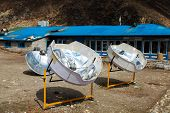 Warming The Teapot In A Solar Cooker. Ecology Concept. Renewable Green Energy. Nepal. Himalaya. poster