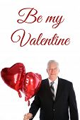 Valentines Day. Red Helium Heart Shape Balloon. A man in a suit holds a Red Heart Shaped Helium Ball poster