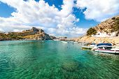 Lindos - View Of St. Paul Bay, Motor Boats Anchored Near Orthodox Church And Acropolis Of Lindos In  poster