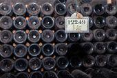 Closeup Pattern From Bottom Of Old Dark Dusty Wine Bottles In Rows In Cellar, Basement, Wine Warehou poster