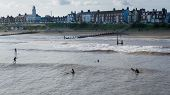 Surfing And Paddle Boarding Southwold Uk And Townscape poster