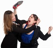 foto of revolt  - Two professional woman fighting over white background - JPG