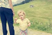 Mother And Cute Daughter Exploring Mountain Pastures. poster