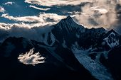 Bright White Cloud In Front Of Kawagarbo Peak In The Himalayas Mountain Range Between Yunnan And Tib poster