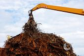 stock photo of polution  - Greater mountain of old rusty scrap metal - JPG