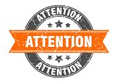 Attention Round Stamp With Orange Ribbon. Attention poster