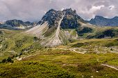 Rock Formation And Alpine Pastures High Up In The Pennine Alps Above Saint-luc Under Dramatic Clouds poster