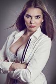 Sexy businesswoman wearing unbuttoned shirt