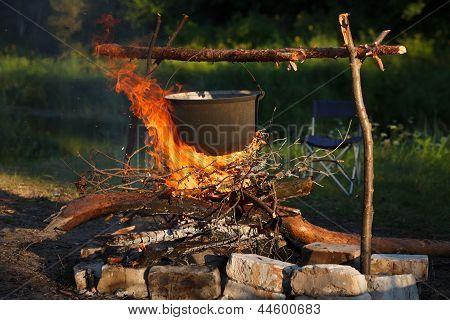 Preparing Food In Big Pot On Campfire