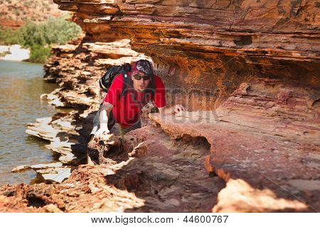 Man Sneak Along Rock Edge