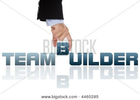 Businesswoman Building Teambuild Word With Letter Blocks