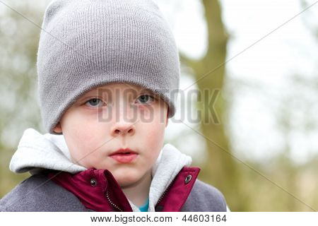 Sad Little Boy Staring Ahead