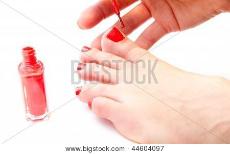 Woman Painting Her Toe Nails Bright Red
