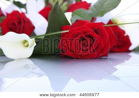 Bouquet Of Fresh Red Roses And Arum Lilies
