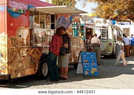 People Buy Meals And Snacks At Food Truck Park