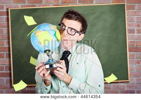 Nerd Man Holding Earth World Globe In Classroom