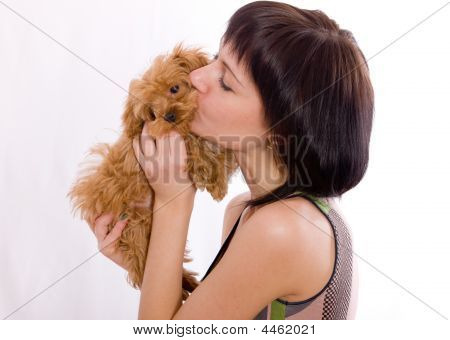 The Girl Kisses A Puppy