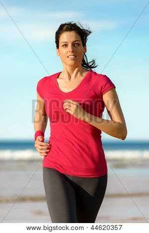 Woman Running On Beach At Sunset