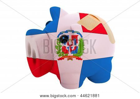 Closed Piggy Rich Bank With Bandage In Colors National Flag Of Dominican