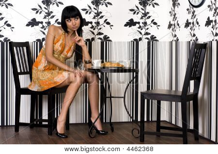 Beautiful Girl Is Sitting In The Cafe