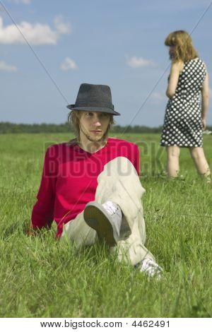 The Young Couple Relaxing On A Meadow Ii